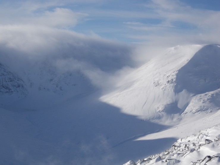 Low level cloud hanging around coire floors, clear on the tops for much of the day.