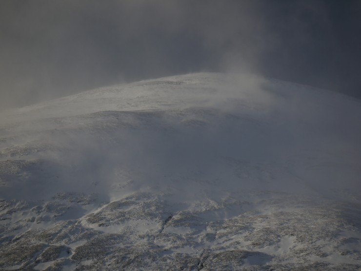 Snow blowing around on Sron a Ghoire. Better visibility between frequent showers.
