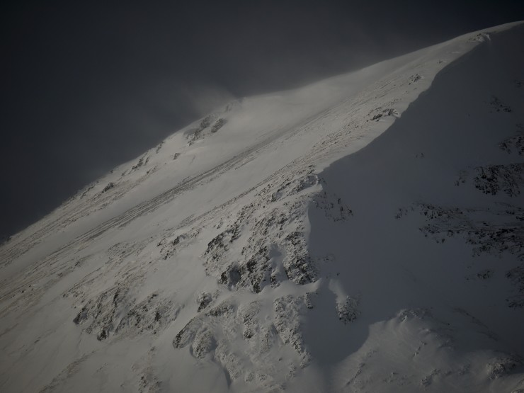 Drifting off the Stob Poite Coire Ardair platau. Today's primary observations took place just below the rocky shoulder of the ridge.