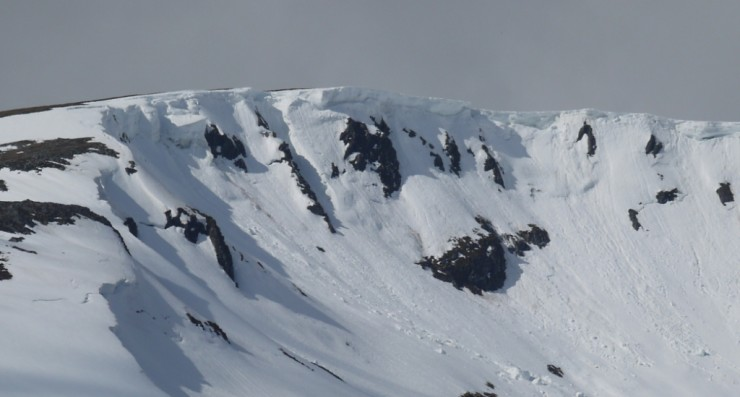 Very large cornices still in situ and weakening in the sustained thaw.