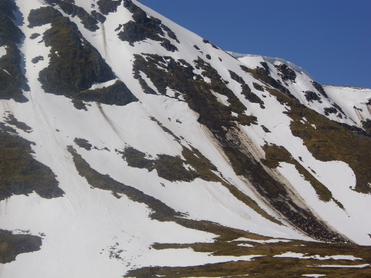 Meall Coire Choillie-rais. Old debris runs on face with a few cornice remnants still to come down.