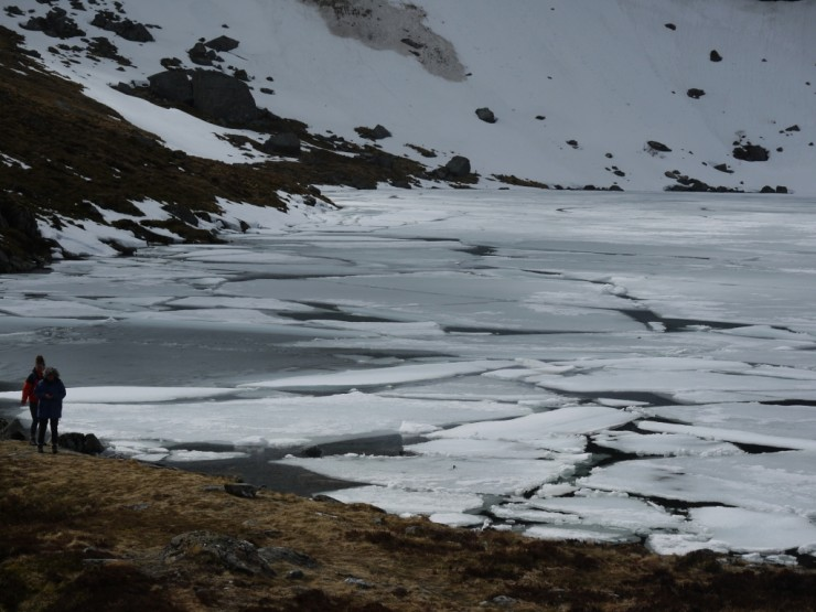 Ice floes on Lochan a Choire below the crags in Coire Ardair.