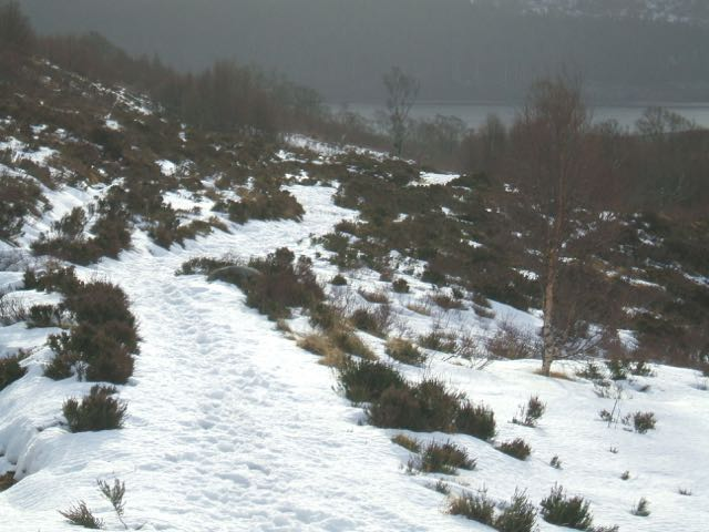 Snow on the Coire Ardair path from about 400m. Some deep drifts further up.
